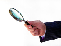 magnifying glass hand