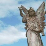 Cemetery angel with a sky on the background
