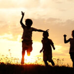 Kids playing on sunset